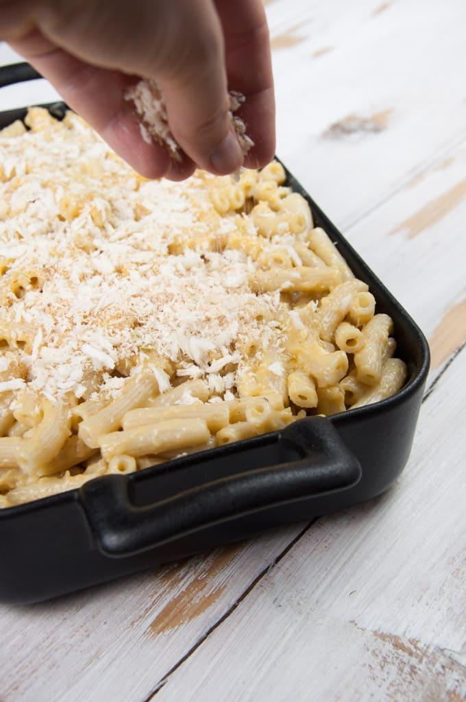Sprinkling Breadcrumbs on vegan Mac and Cheese
