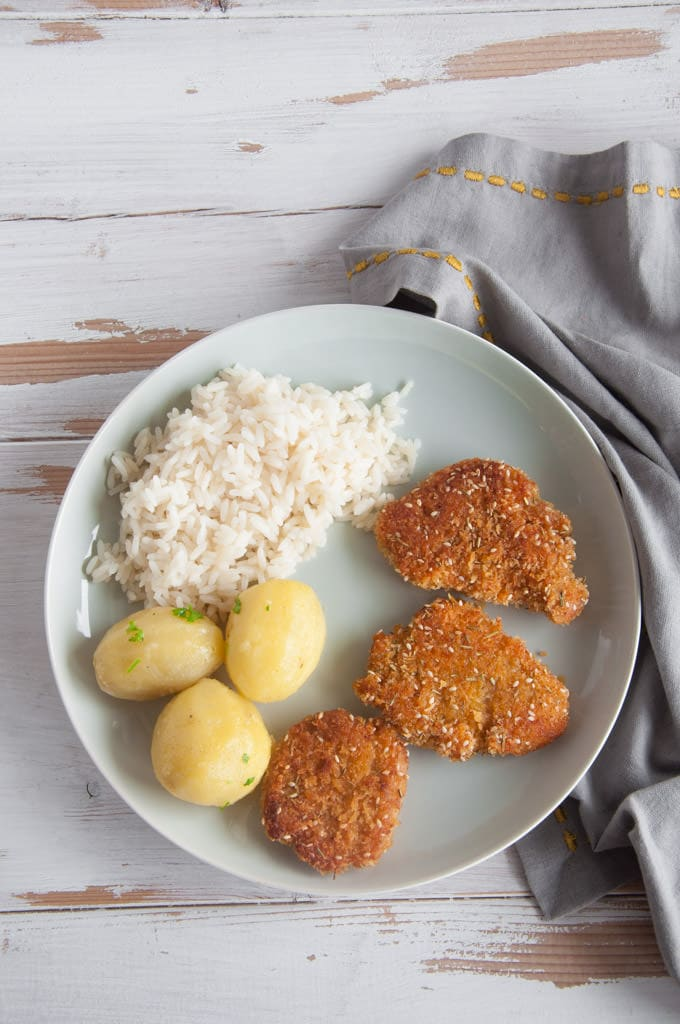 Vegan Schnitzel with parsley potatoes and rice