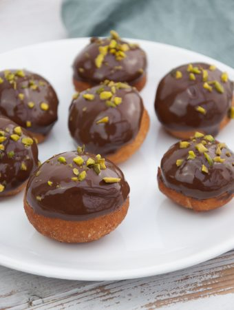 Vegan Donut Holes with chocolate and pistachios
