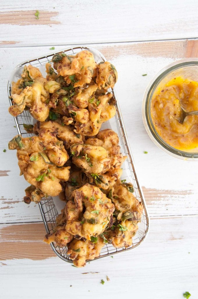 Vegetable Pakoras being served with Mango Chutney