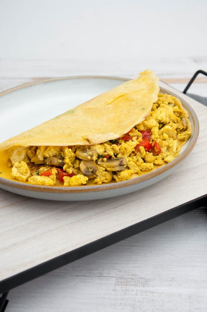 Tofu Scramble with Mushrooms and Bell Pepper in a chickpea omelet