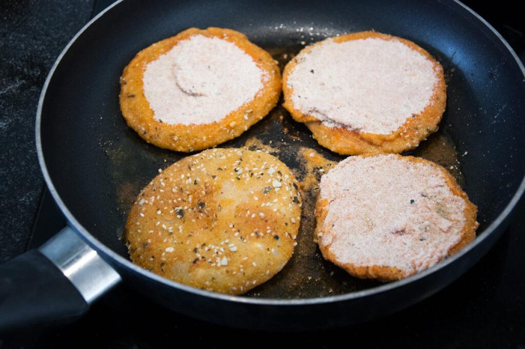 breaded kohlrabi slices in pan