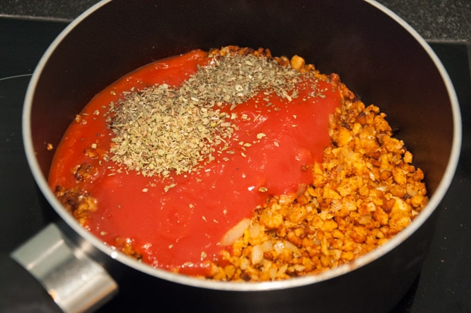 soy granule, tomato puree, and spices in a pot