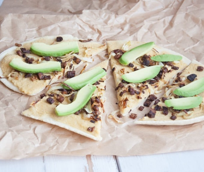 Vegan Tarte Flambée with caramelized onions, smoky tempeh bits & avocado