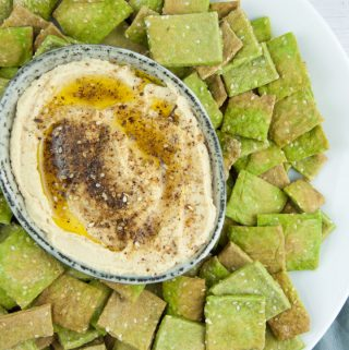 Vegan Spinach Sesame Crackers served with Zaatar Hummus
