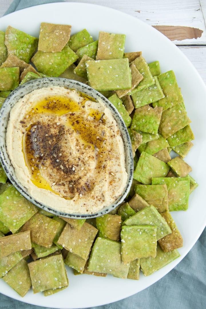 Vegan Spinach Sesame Crackers served with Zaatar Hummus
