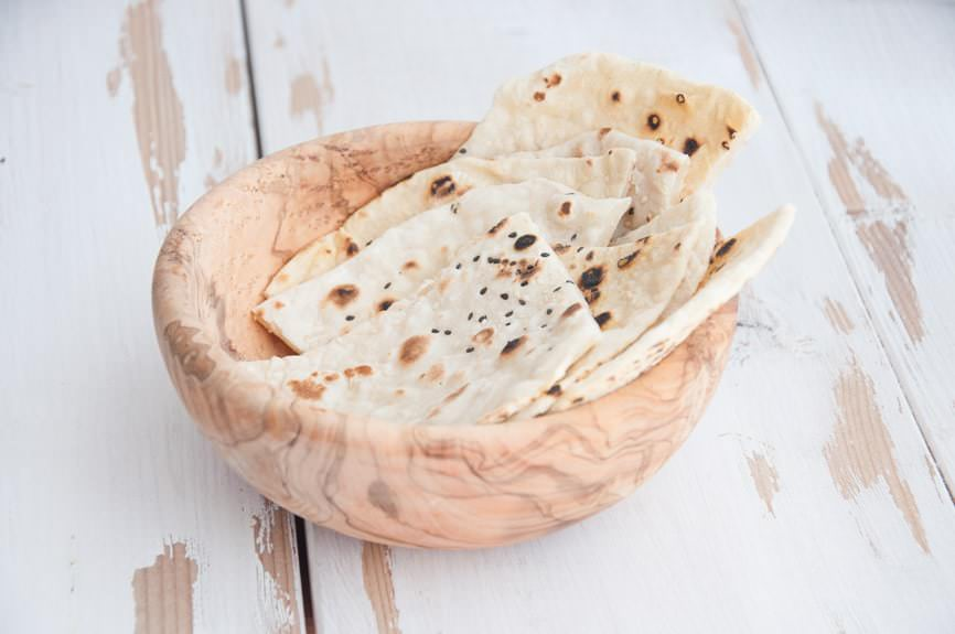 Sesame Naan in a wooden bowl