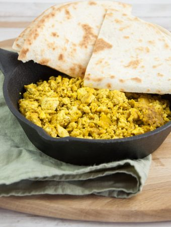tofu scramble in a pan served with tortillas