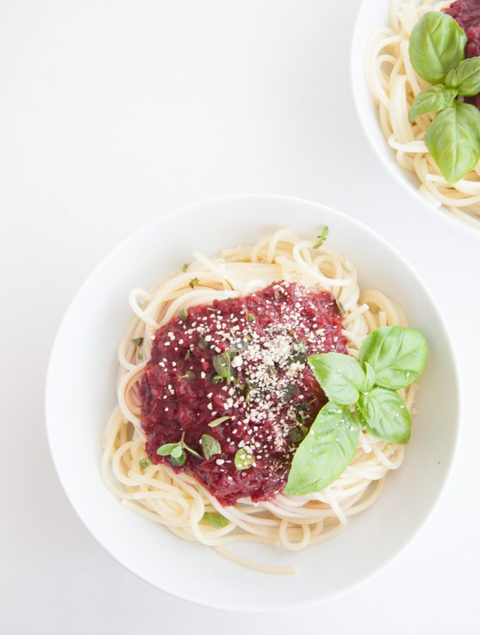 Fruity & Purple Spaghetti Bolognese topped with cashew parmesan and fresh basil