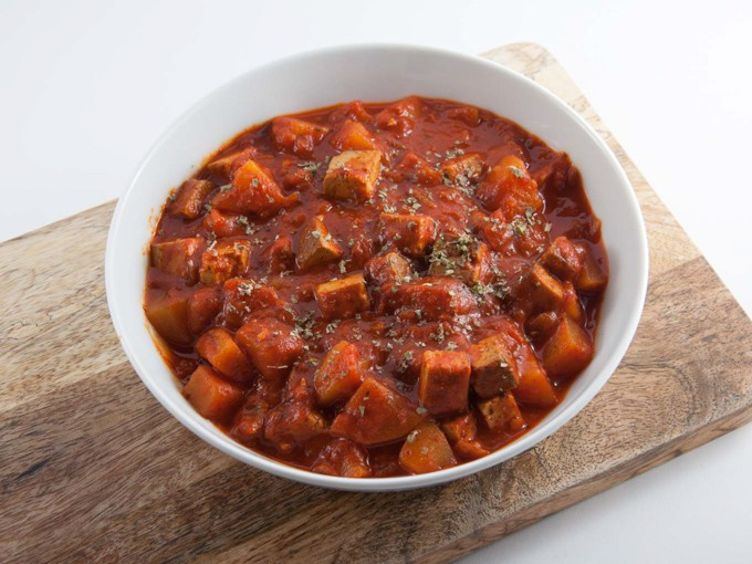 Vegan Goulash with smoked tofu and potatoes in a white bowl