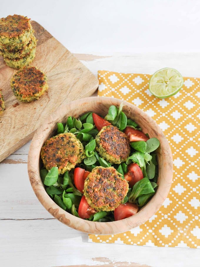Green Falafel on a salad with tomatoes