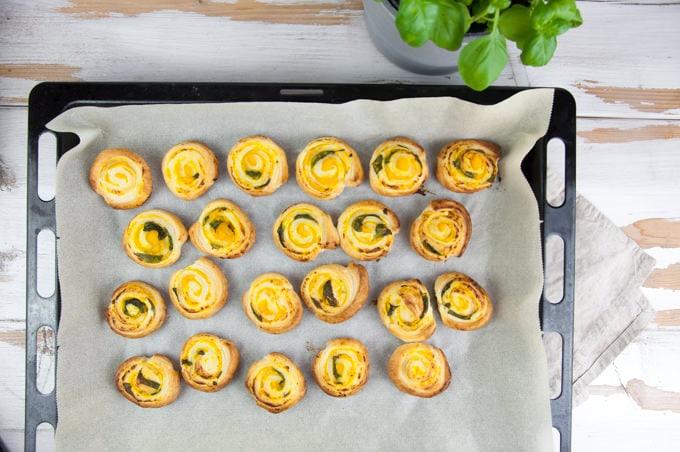 pumpkin basil pinwheels on a baking tray after baking