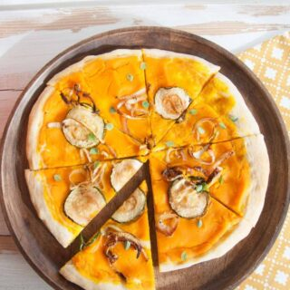 Vegan Pumpkin Pizza with zucchini and caramelized onions