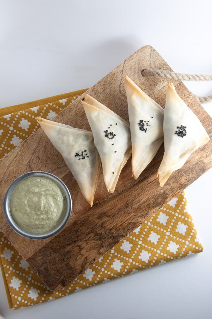 Baked Samosas filled with spinach & potatoes served with a cilantro sunflower seed sauce