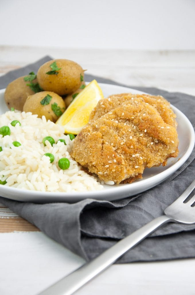vegan schnitzel served with rice & peas, and potatoes
