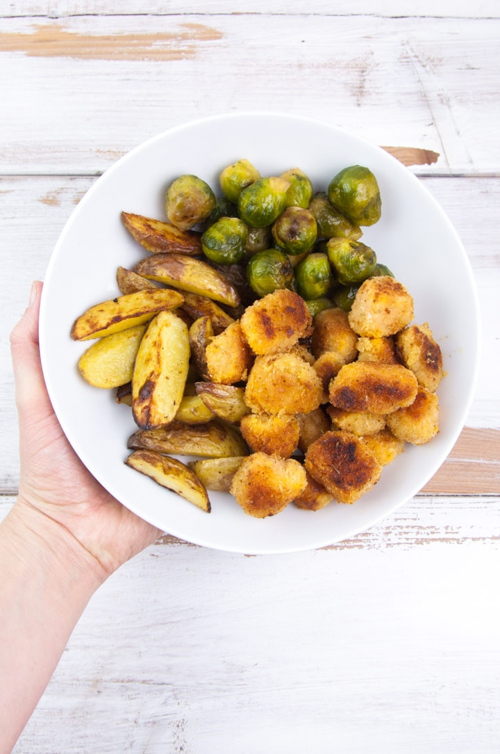 vegan pumpkin nuggets with brussels sprouts and wedges