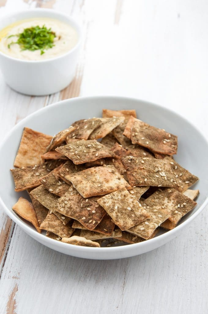 Vegan Za'atar Crackers in a bowl with hummus