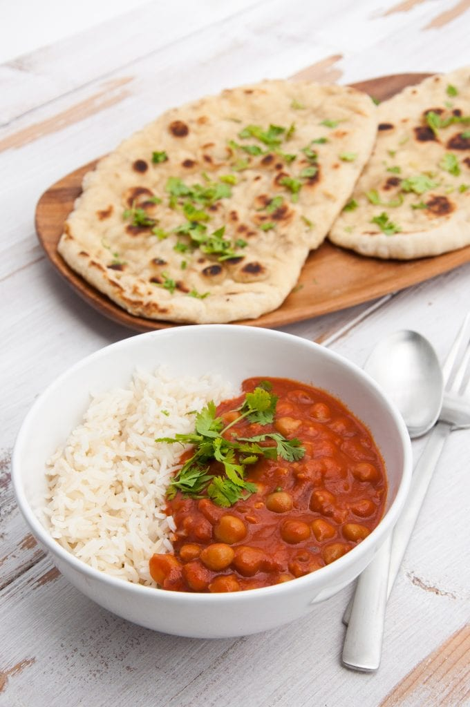 Tomato Coconut Chickpea Curry with white rice and cilantro naan