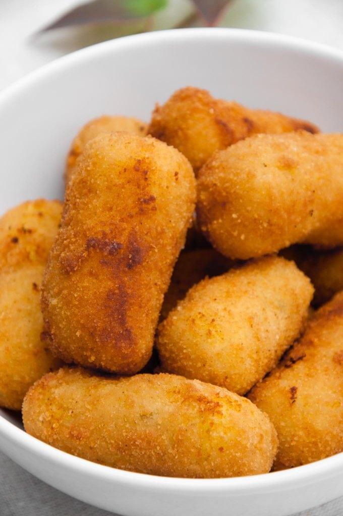 Golden Potato Croquettes in a white bowl