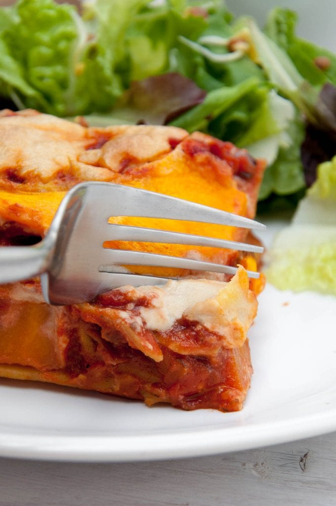 Digging into a piece of Pumpkin Lasagne with Cashew Cheese