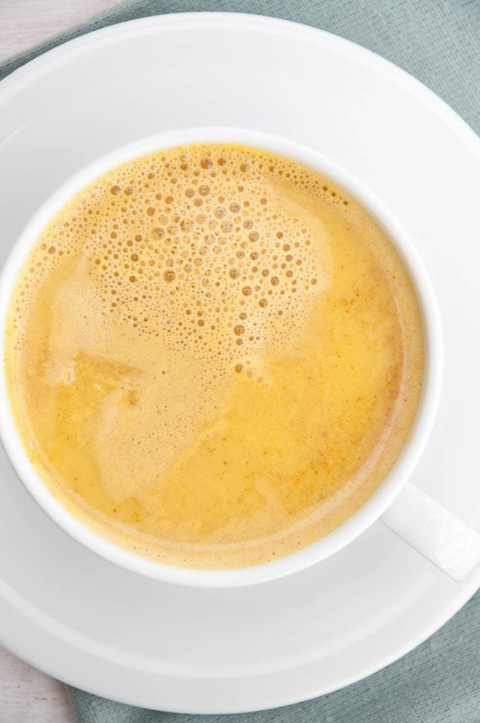 Golden Milk with turmeric and cinnamon in a cup