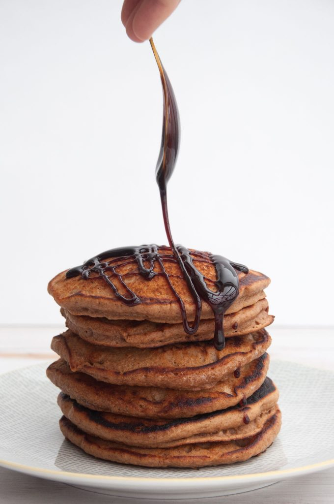 Vegan Gingerbread Pancakes drizzled with date syrup