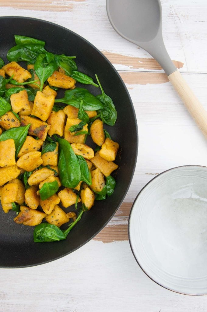 Crispy Pumpkin Gnocchi with spinach in pan