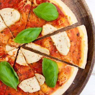 Cashew Mozzarella on pizza with basil
