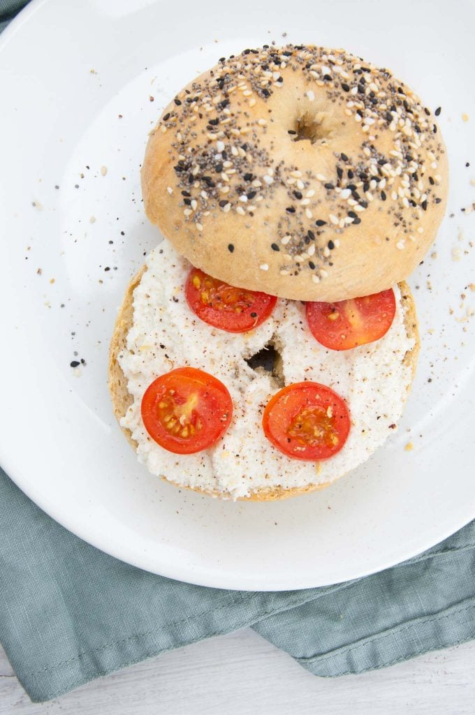 Everything Bagels with cream cheese, cherry tomatoes and cracked pepper