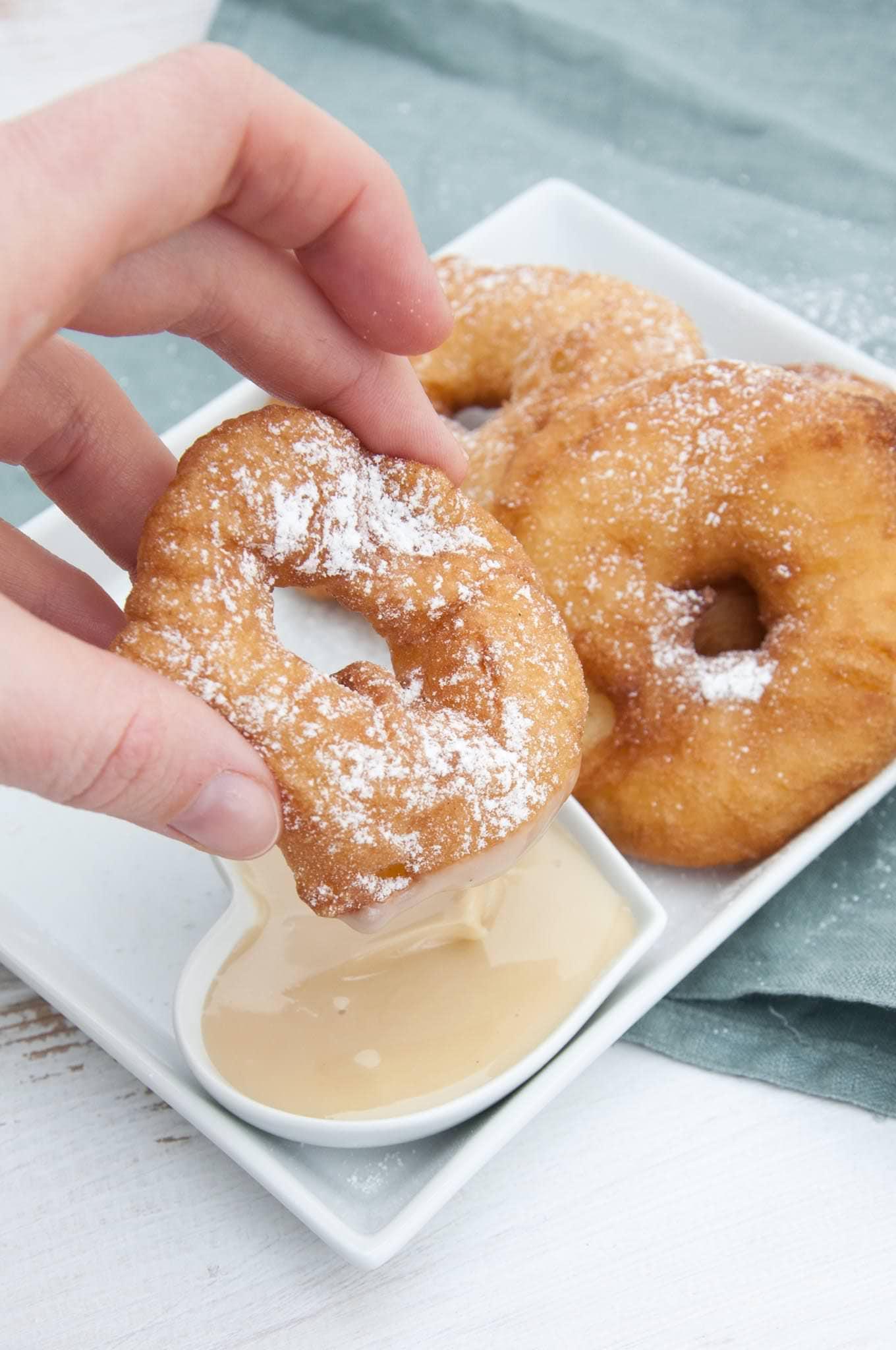 Vegan Apple Fritter Rings dipped in almond maple sauce