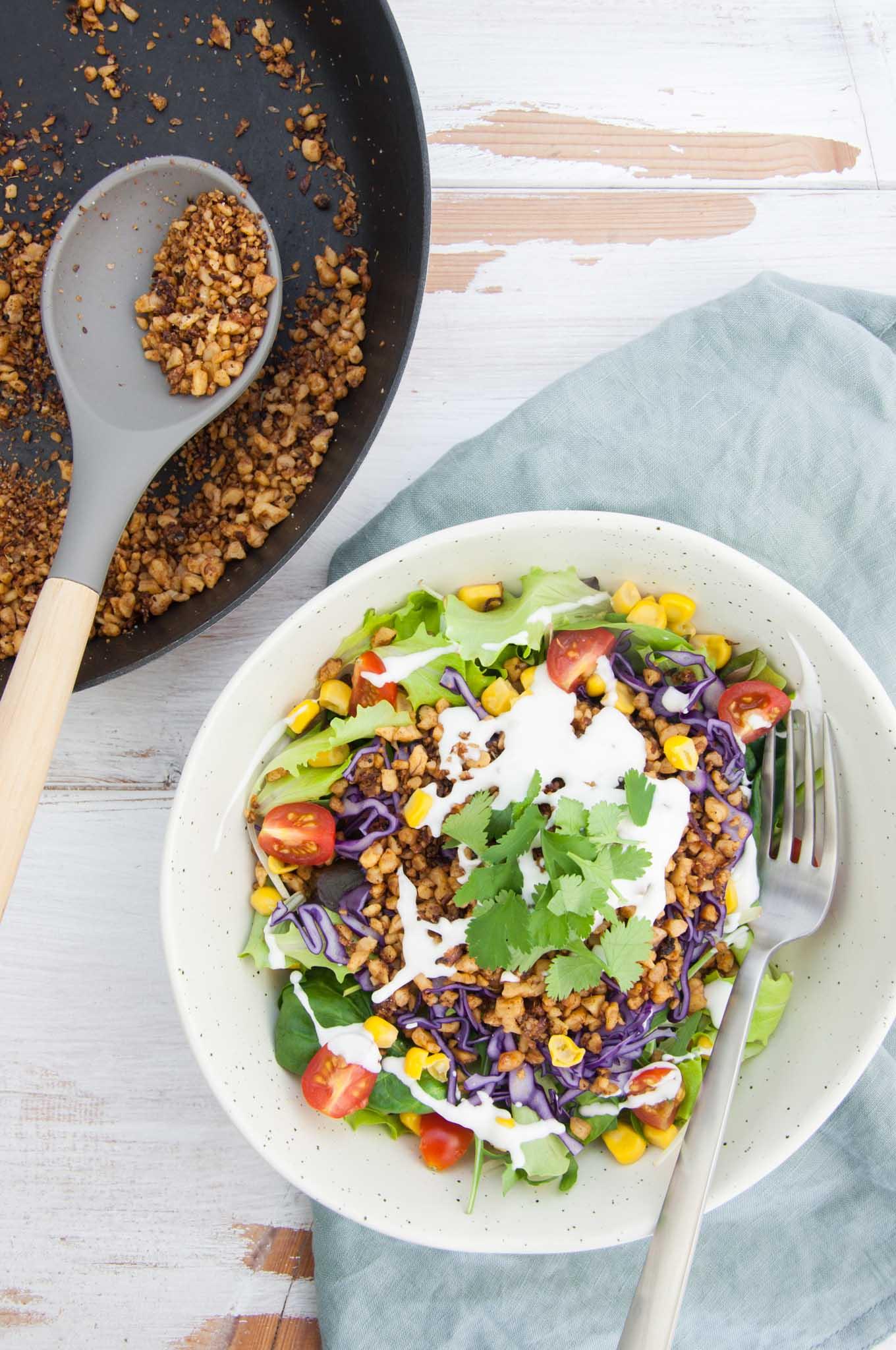 Vegan Taco Salad with Walnut Meat, corn, cabbage, tomatoes, vegan mayo and cilantro