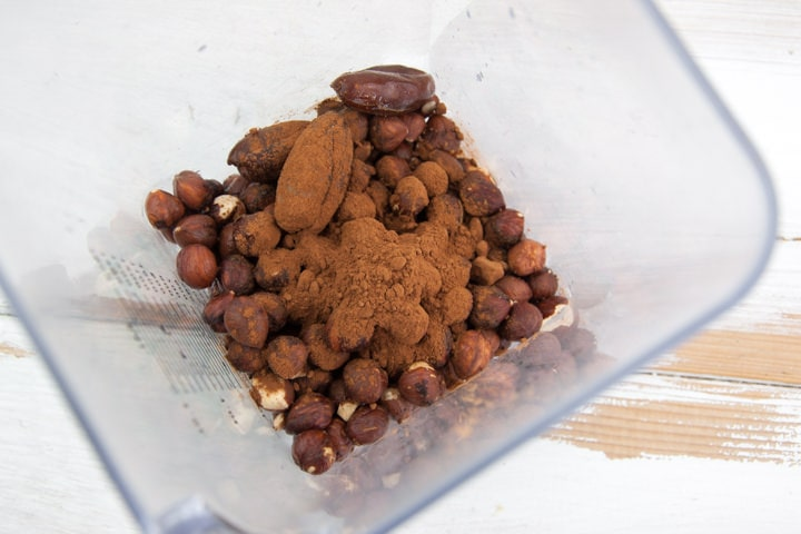 hazelnuts, dates, and cocoa powder in blender