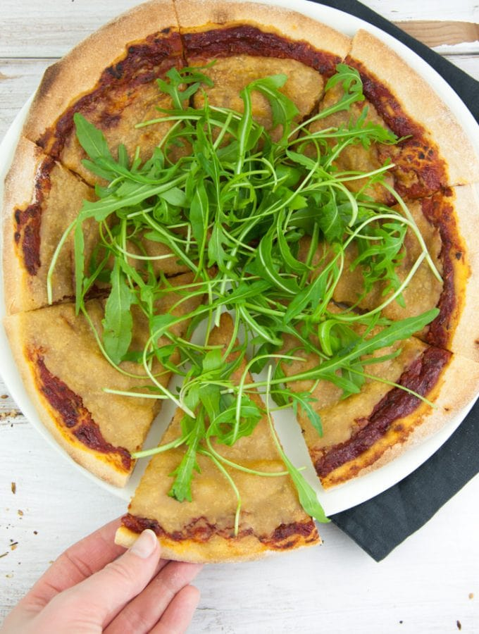 Vegan Cheese Pizza topped with arugula