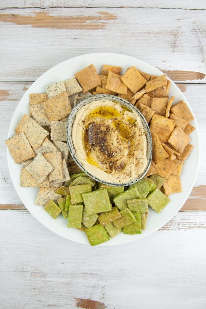 Za'atar Hummus served with pizza, spinach and poppy seed crackers