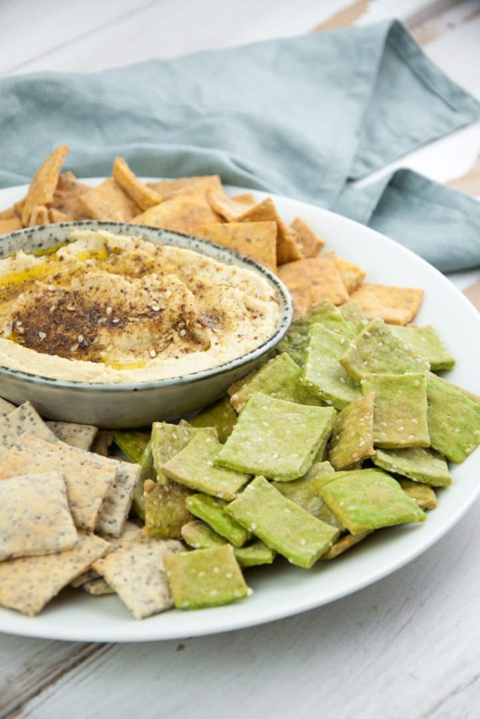 Za'atar Hummus served with colorful crackers