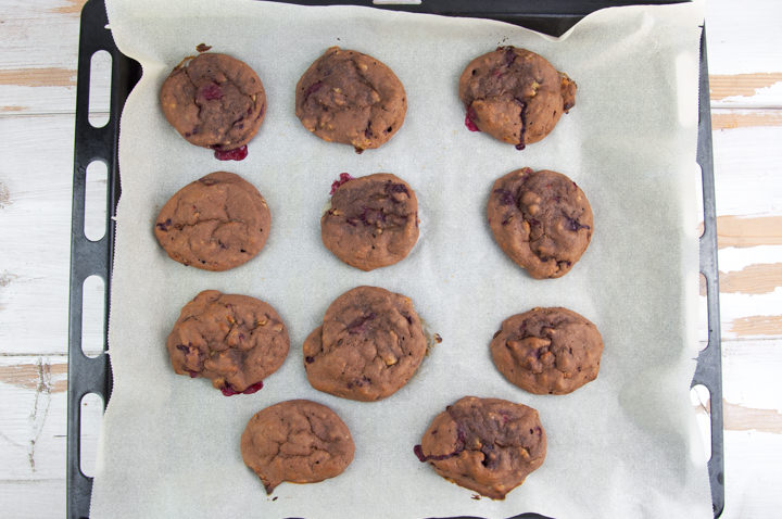 Sugar-Free Chocolate Cookies with Raspberries on a baking tray