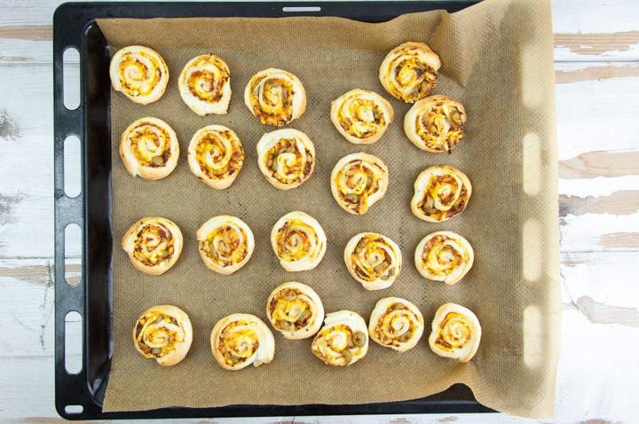 Vegan Pizza Pinwheels with olives on a baking tray
