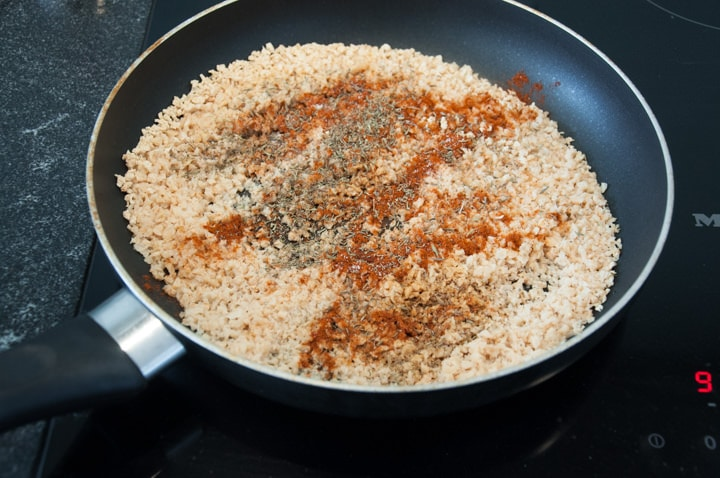 soy granule and spices in a pan