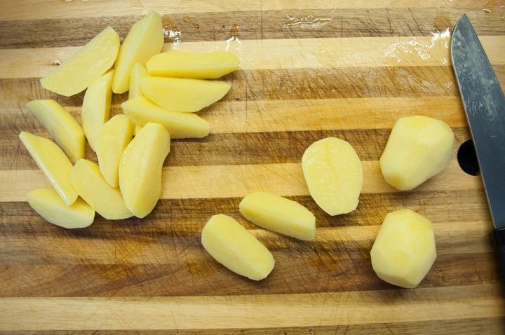 cutting potatoes in wedges