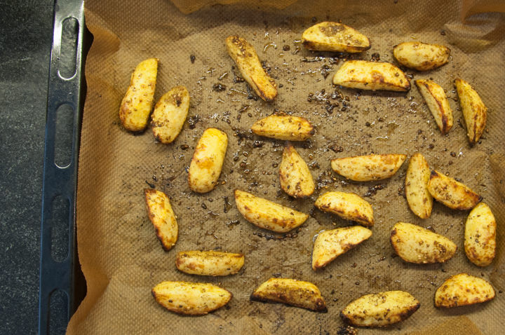 potato wedges on a baking tray