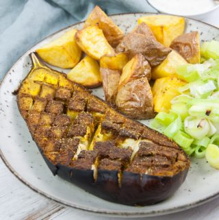 oven roasted eggplant with ras el hanout seasoning served with potato and leeks
