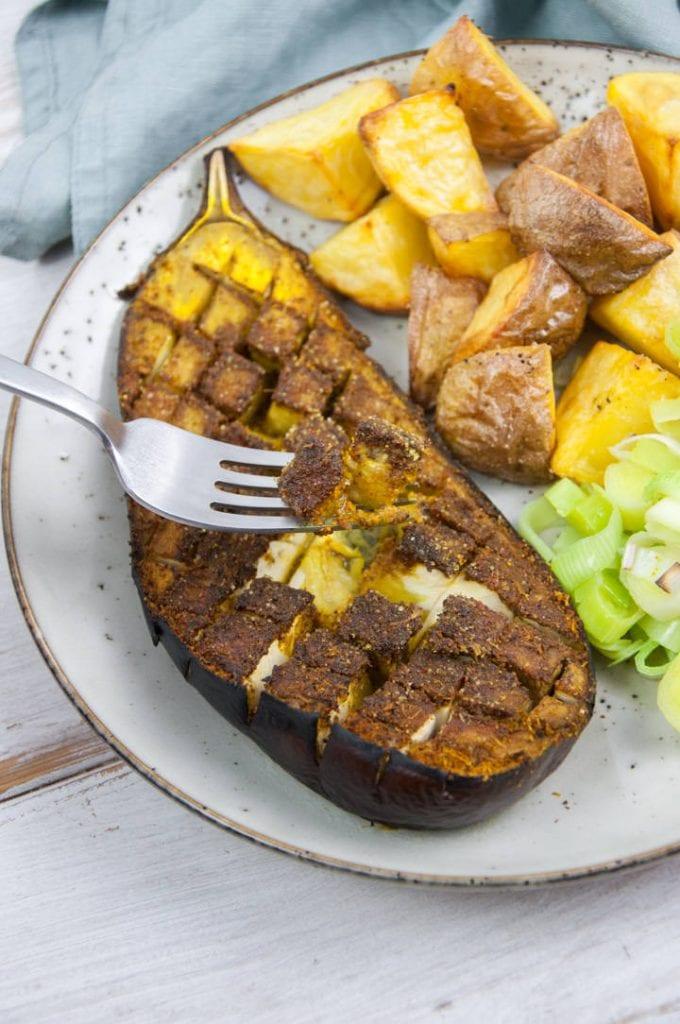 fork digging into oven-roasted eggplant