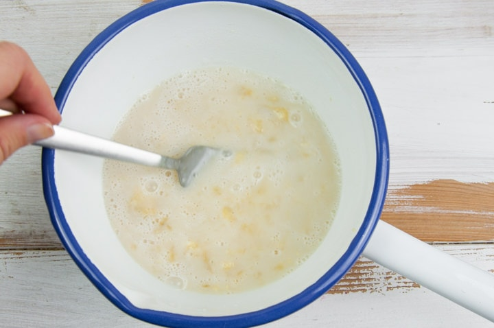 mashed banana, maple syrup and plant-based milk in a bowl