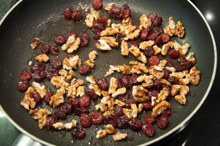 walnuts and cranberries in pan