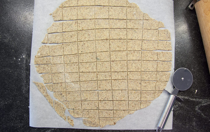 unbaked crackers on parchment paper