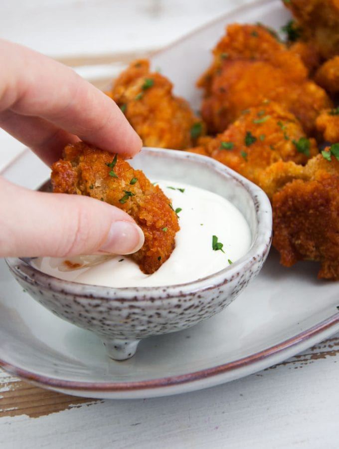 spicy cauliflower wings dipped in mayo