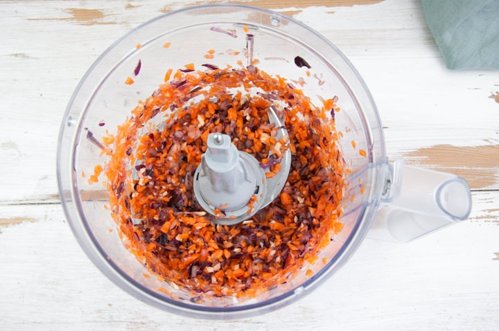 onions, garlic and carrots in a food processor