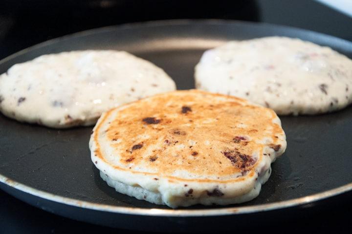 Chocolate Raspberry Pancakes in a pan