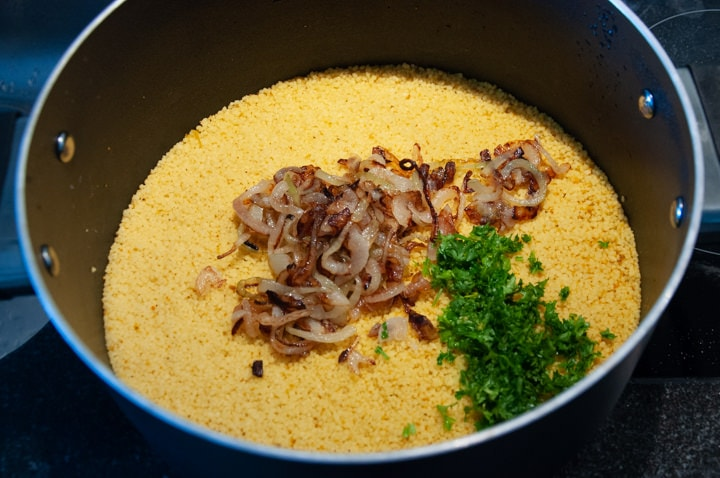 couscous, onions and parsley in a pot