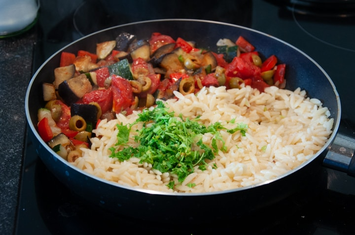 orzo pasta and veggies in a pan